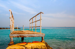 Rusty Pier and blue sea Stock Image