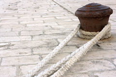 Rusty pier with ropes. Stock Photography