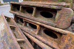 Rusty pile of iron sleepers Royalty Free Stock Photography