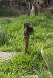 Rusty pipe in the garden Stock Photo