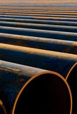Rusty pipes. Metal pipes laid out in a row for installation Royalty Free Stock Photo