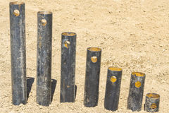 Rusty pipes stand. In a row on the growth on the ground Royalty Free Stock Photo