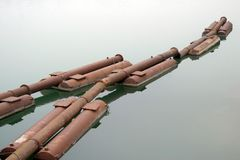 Rusty pipes in the water. Rusty old pipes in the water stock image