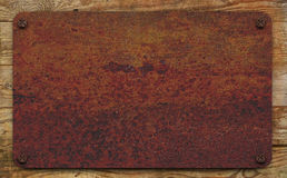 Rusty plate on boards Royalty Free Stock Photos