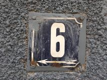 Rusty plate of number of street. Vintage grunge square metal rusty plate of number of street address with number 45 closeup Stock Photo