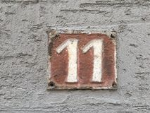 Rusty plate of number of street. Vintage grunge square metal rusty plate of number of street address with number 191 closeup Stock Photography