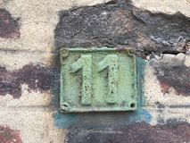Rusty plate of numbers of street Stock Images
