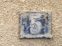 Rusty plate of numbers of street Royalty Free Stock Image
