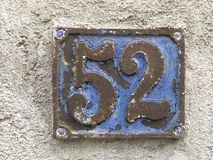 Rusty plate of numbers of street Stock Photography