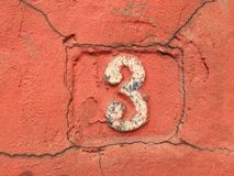 Rusty plate of numbers of street Stock Photos