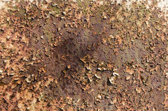 Rusty plate. Old rusty metal plate with paint peeling off Stock Image