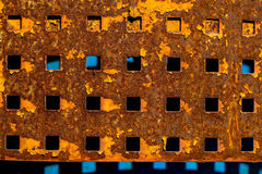 Rusty plate with square holes Royalty Free Stock Photos