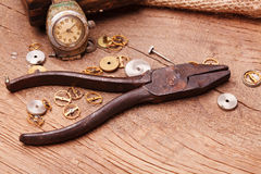 Rusty pliers and gears. Photo of rusty pliers and gears Stock Images