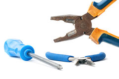 Rusty pliers and screwdriver on white closeup Royalty Free Stock Photography