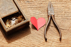 Rusty pliers and a wooden box with gears Royalty Free Stock Photo