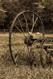 Rusty plough. Rusty old plough standing in a field of grass in sepia Stock Photography