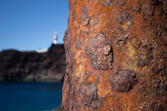 Rusty pole at coastline ocean background , rust / rusted metal Stock Image