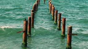 Rusty poles in the sea. Video stock video