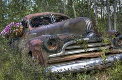 Rusty 1947 Pontiac Streamliner with flowers Royalty Free Stock Images
