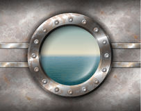 Rusty porthole with seascape. Old rusty porthole with rivets and seascape outside Royalty Free Stock Images