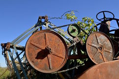 Rusty pulleys of a self propelled combine Royalty Free Stock Photography