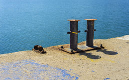 Rusty pylons in harbor Royalty Free Stock Images