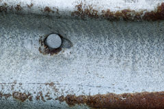 Rusty rail. Metal fastener on a rusty old steel rail stock photography