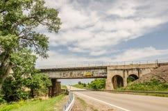 Rusty Railroad Bridge Over Country Road Stock Photos