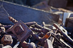 Rusty railroad nails in trash box Royalty Free Stock Photography