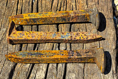 Rusty railroad spikes laying on ground in a pile stock photos