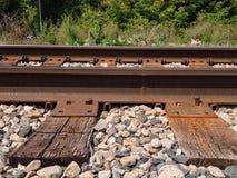 Rusty Railroad Tracks Through Town Arkivfoton