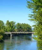 Rusty Railroad trestle over a river Stock Images