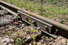 Rusty rails of the abandoned railroad in the forest. Perspective view stock images