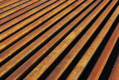 Rusty rails lined-up. Close as background perspective stock photography