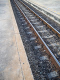 Rusty railway on concrete sleepers. Royalty Free Stock Photography