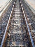 Rusty railway on concrete sleepers. Stock Photo