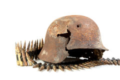 The rusty raked helmet and machine-gun tape Stock Photo