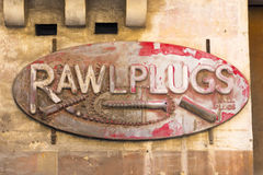 Rusty Rawl Plugs Sign Stock Photography