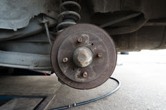 Rusty Rear Car Wheel Hub with Drum Brake System and Suspension Royalty Free Stock Photography