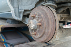 Rusty Rear Car Wheel Hub with Drum Brake System and Suspension Stock Image