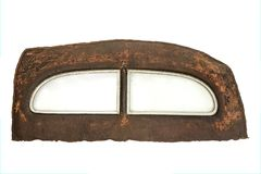 Rusty rear end with window of a vintage car. Isolated on white background Stock Image