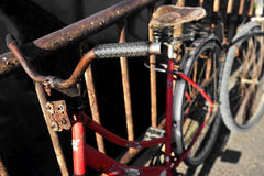 Rusty red bicycle Stock Photos