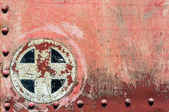 Rusty red plus add cross sign symbol on old metal background tex Royalty Free Stock Images