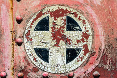 Rusty red plus add cross sign symbol on old metal background tex Stock Photo
