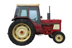 Rusty red tractor (isolation) Royalty Free Stock Images