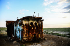 Rusty remains of a fishing ship. At the bottom of the dried-up Aral Sea Royalty Free Stock Photography