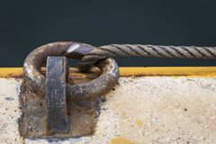 Rusty mooring ring. Rusty ring for the mooring of a fishing vessel in port Stock Images