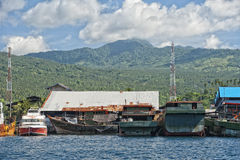 Rusty rugged ship in indonesia harbor Stock Photography