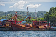 Rusty rugged ship in indonesia harbor Royalty Free Stock Photo