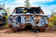 Rusty Salvage Yard Car royaltyfria bilder